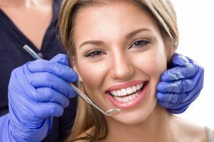 woman smiling happy white teeth dentist